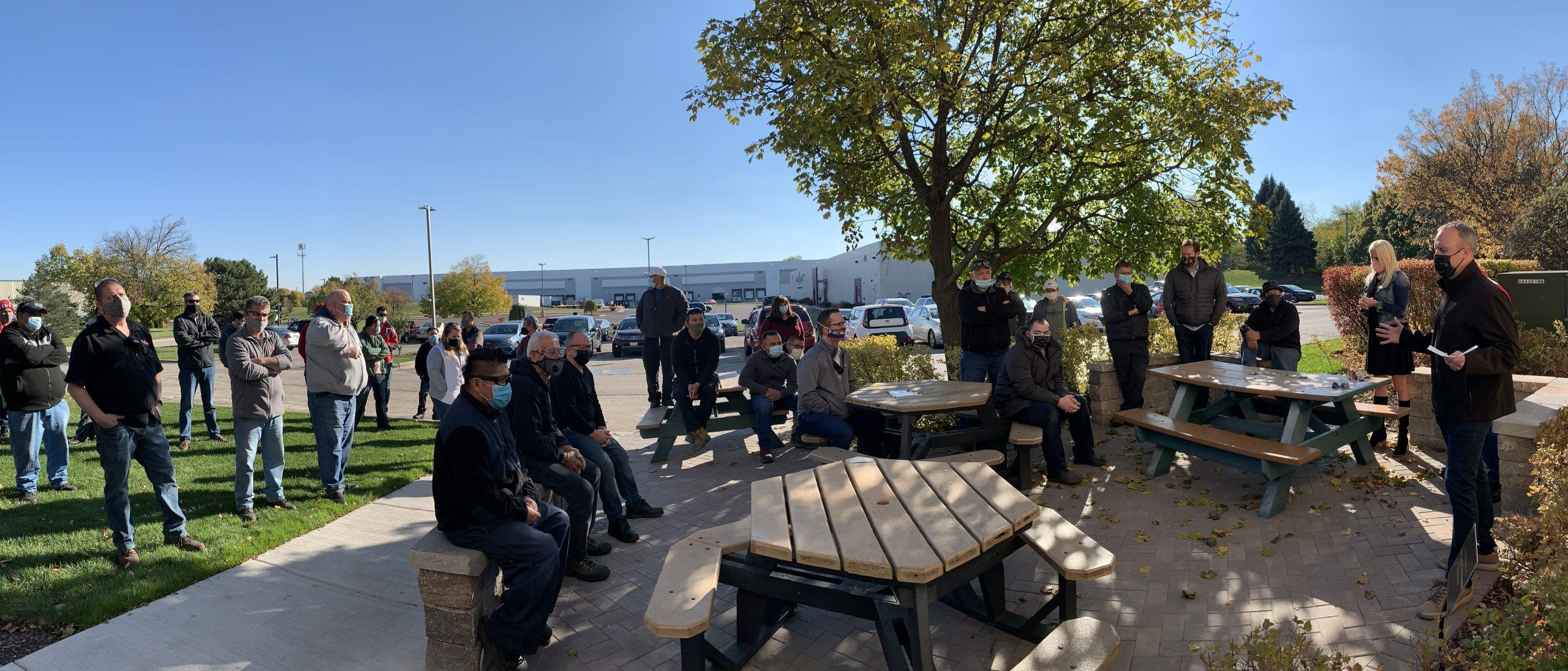 Simmons employees gather on the new patio to celebrate Big Krys