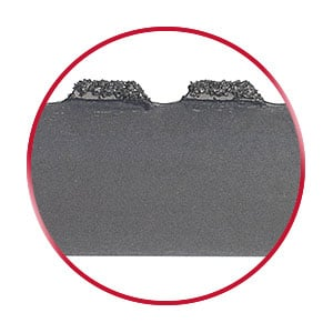 Gulleted edge Carbide Grit bandsaw blade in a red circle