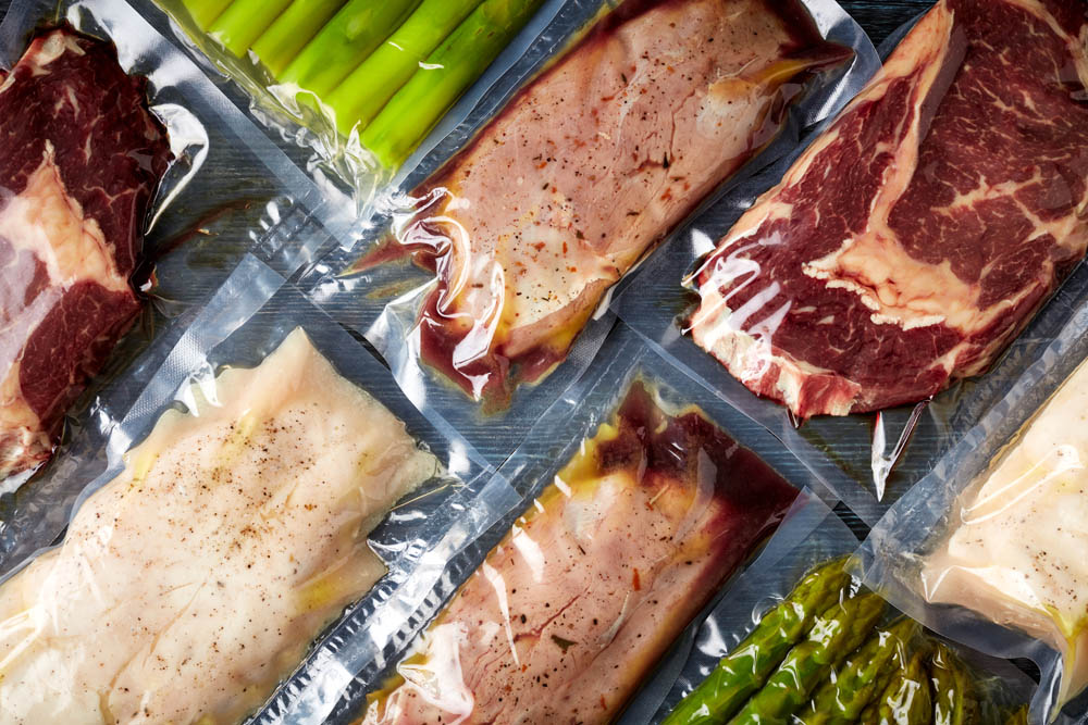 Assortment of vacuum sealed meat, poultry, and vegetables